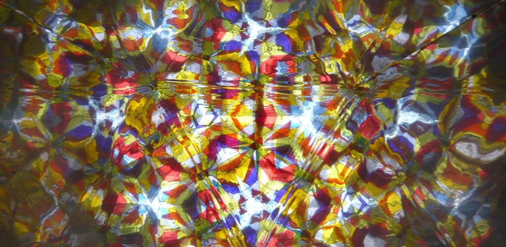 a view through the lens of a kaleidoscope shows facets as an analogy to data mashing