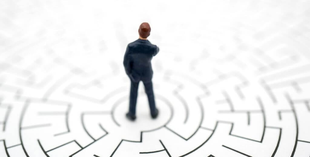 tilt shift style image of a man inside a drawing of a maze