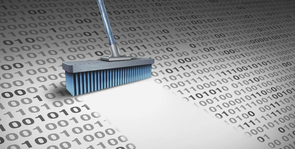a broom sweeping 0's and 1's - binary data purged from database